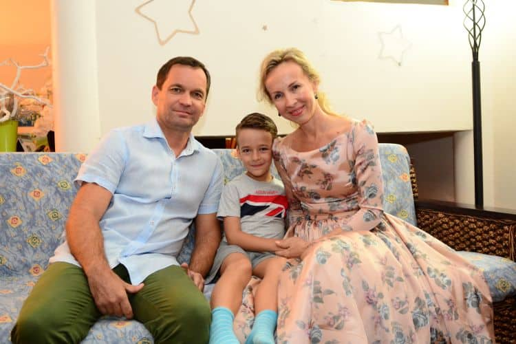 Gleb with his parents, Sergey and Marina