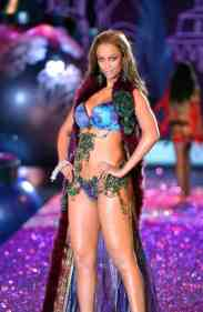 Tyra Banks walks the runway during the 2010 Victoria's Secret Fashion Show
