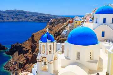 Blue domed churches on the Caldera at Oia on the Greek Island of Santorini