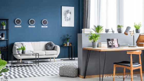 blue wall living room with white couch