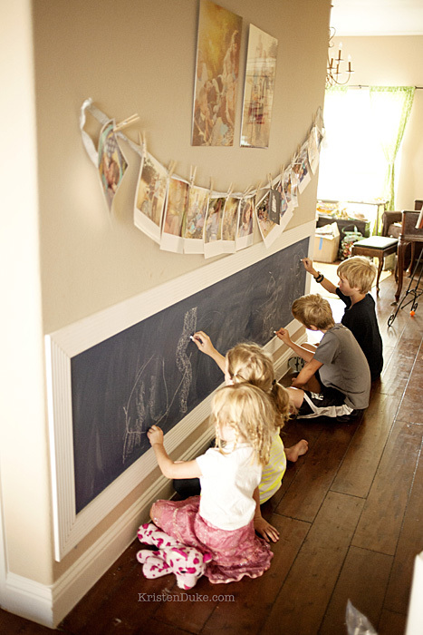 kids writing on chalkboard wall
