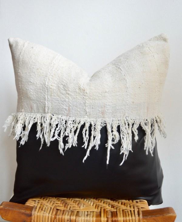 black faux leather + white mudcloth pillow