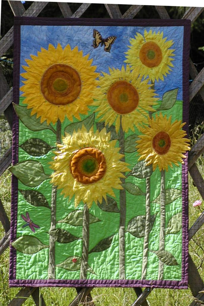 A quilt commission featuring sculpted sunflowers.