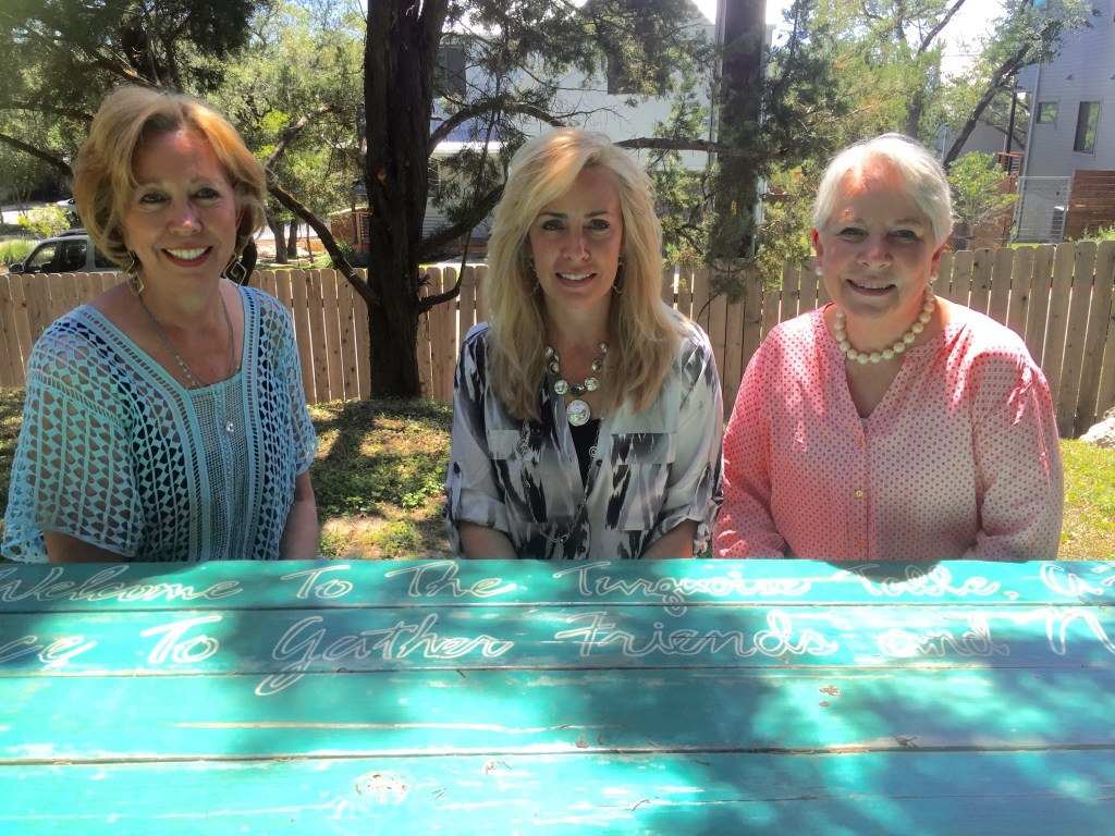 Three women collaborate to bring the Turquoise Table to their office building courtyard. Coworkers make awesome Front Yard People.