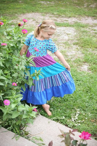 I just fell in love with this tiered peasant dress.  It just begs for a barefoot, summer time stroll!