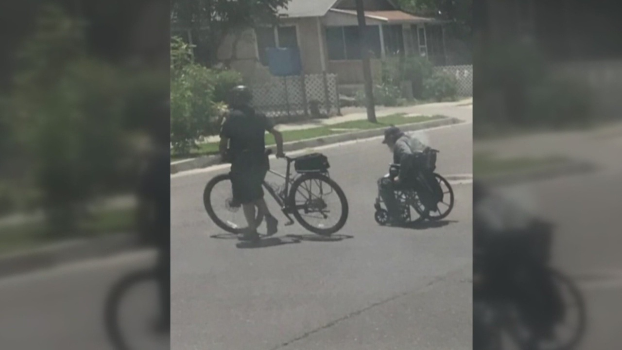 APD officer caught on camera helping man in wheelchair_1557877978858.jpg.jpg
