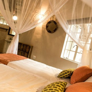 Sefapane River Lodge Rondavel Bed