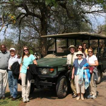 Baluleni Safari Lodge Standing by Vehicle