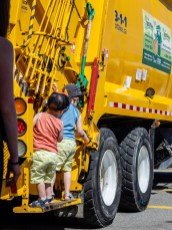 Kids playing on the garbage truck