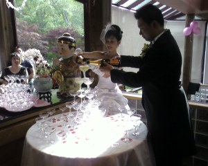 Keith and Carmen pouring Champagne
