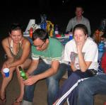 jeani, andrew, and lorie chilling next to the camp fire