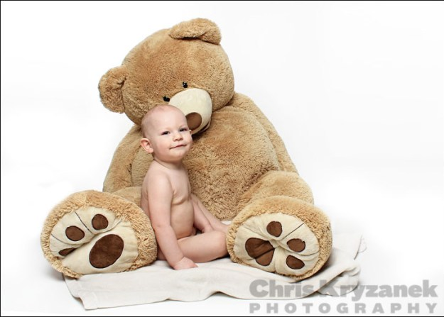 Baby with giant bear and white background