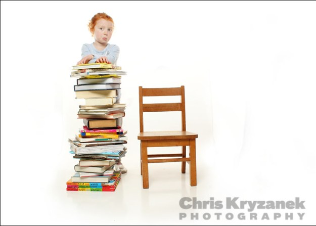 Girl with books and chair photo