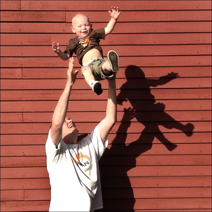 Dad with baby tossing in the air