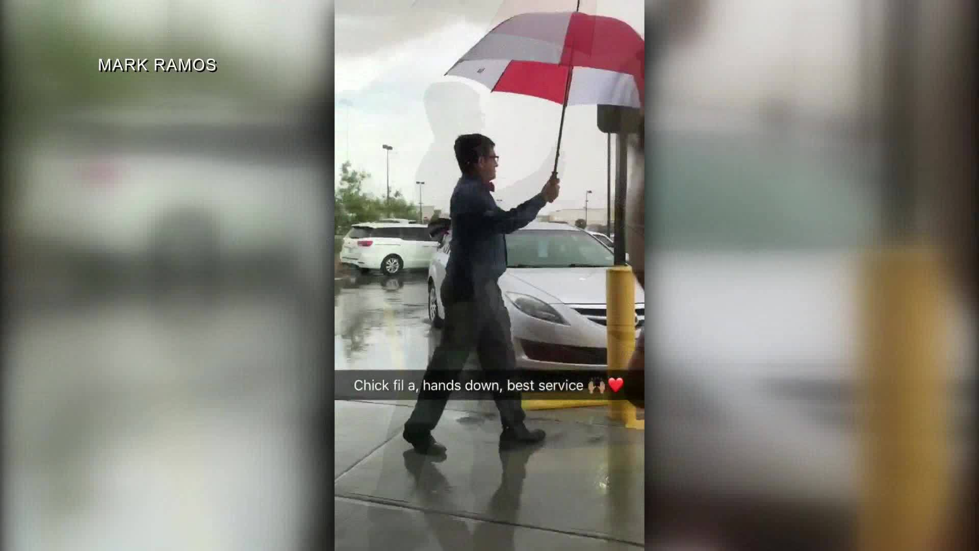 Local Chick-fil-A employee escorts customers in rain, goes viral