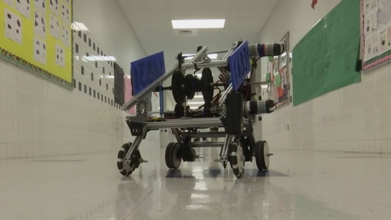 Middle school robotics students compete against best high schoolers in region
