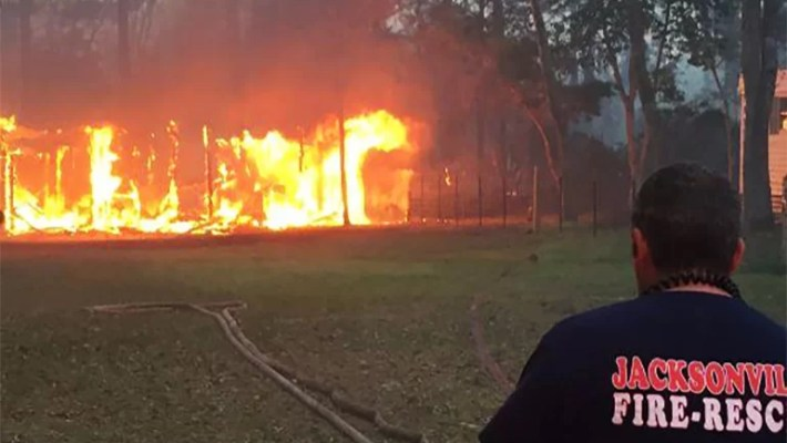 Book burning starts Florida wildfire, 10 homes destroyed