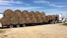Truck with large bales of hay