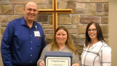Tabby McCullough receives the Wright Memorial Hospital Employee of the Quarter Award for first quarter 2018 from Gary Jordan, CEO, and Mandy Willey, Supervisor, Patient Access.