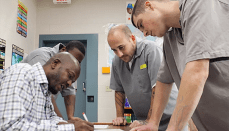 Prison inmates doing paperwork