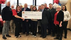 Holding the check, from left to right, Randie Toto (Casey's General Stores store manager), Mike Richardson (Casey's General Stores Vice President of Marketing), Robin Kelleher (Hope For The Warriors President and CEO) and Terry Handley (Casey's General Stores President and CEO) surrounded by Casey's General Stores and Hope For The Warriors team members in Siloam Springs, Arkansas