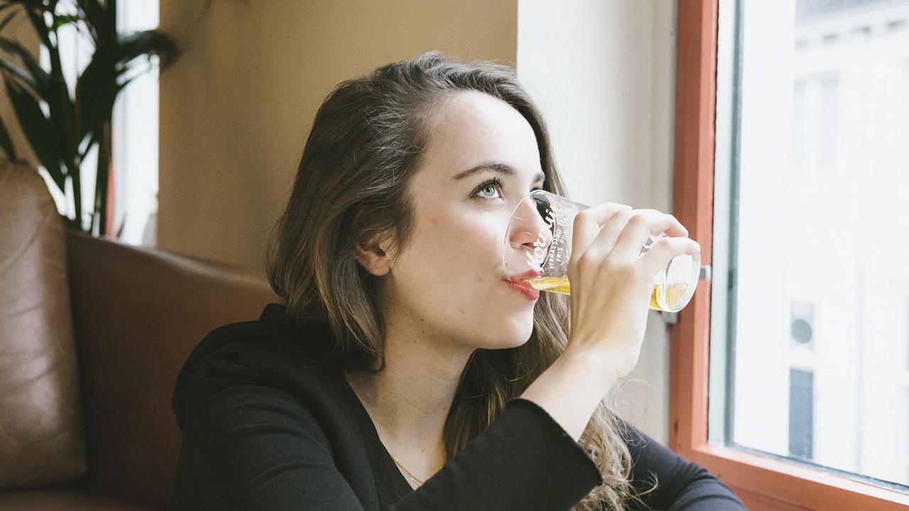 Woman Drinking Beer - Joren Aranas