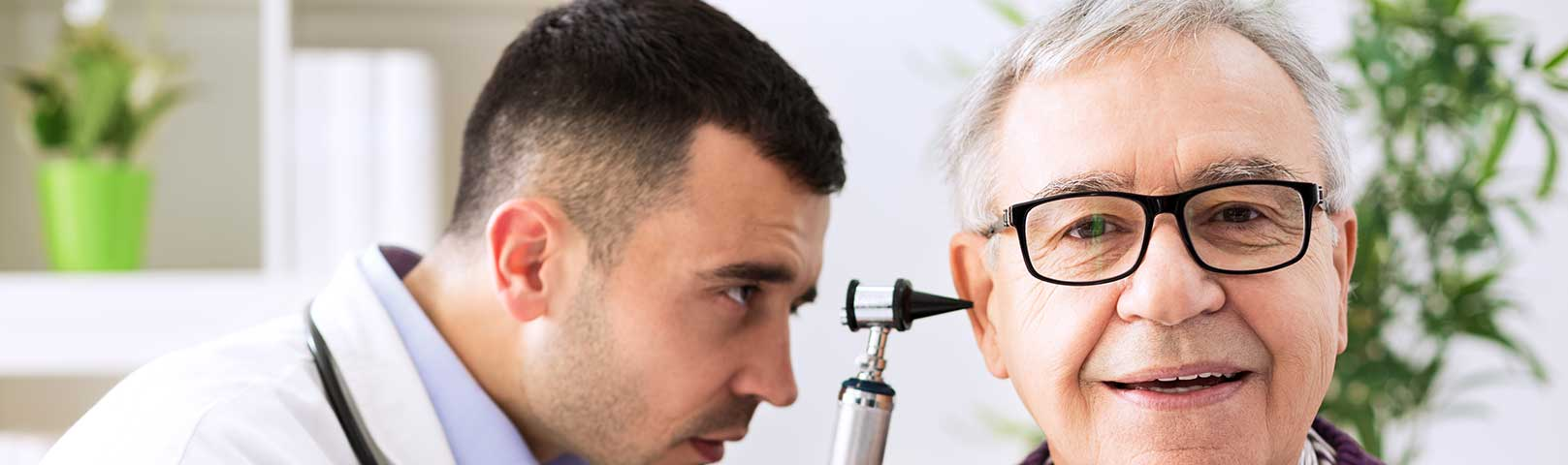 Audiologist looking at a patient with Hearing Loss