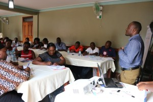 SUI's Deputy ED Moses Kimbugwe speaking to participants