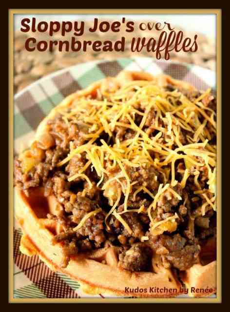 Sloppy Joes Over Cornbread Waffles with shredded cheese - kudoskitchenbyrenee.com