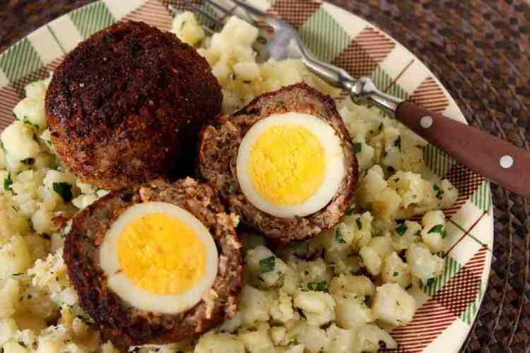 Scotch Eggs wrapped in sausage.