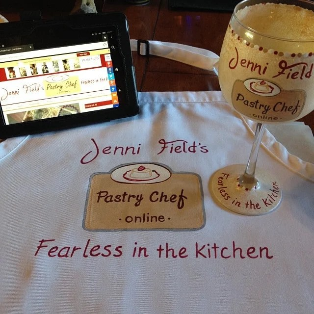 Hand painted food blogger wine glass and apron.