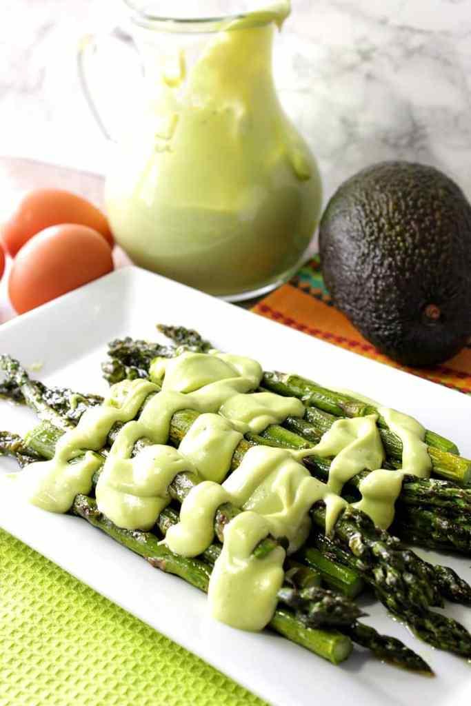 Creamy Avocado Hollandaise Sauce over Roasted Asparagus - kudoskitchenbyrenee.com