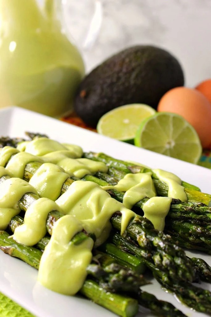 Creamy Avocado Hollandaise Sauce over Oven Roasted Asparagus with Lime