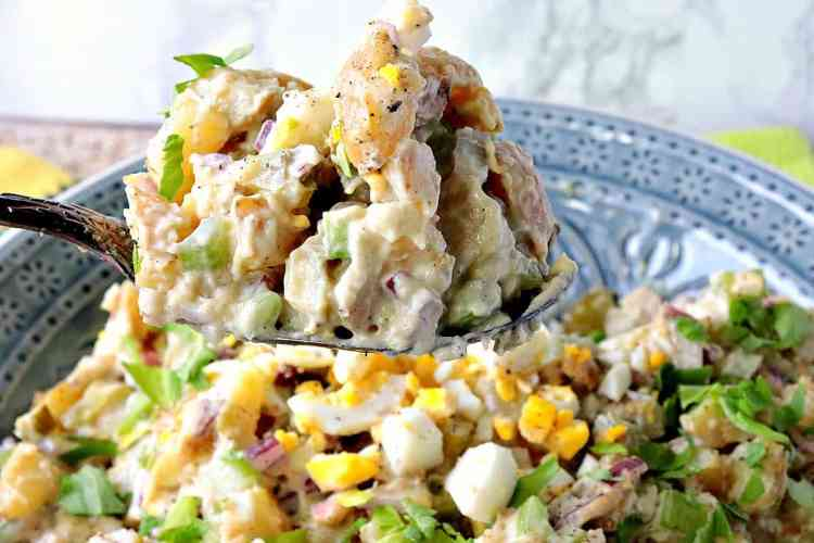Creamy Golden Pijon Potato Salad with celery, red onion, and a few other surprises. - kudoskitchenbyrenee.com