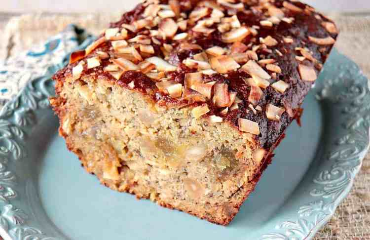 Gluten Free Tropical Banana Bread with Almond Flour, Macadamia Nuts, Pineapple, and Coconut Chips is utterly delicious! - kudoskitchenbyrenee.com