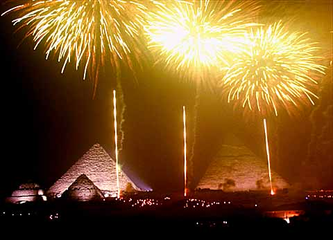 Fireworks iluminate the Giza pyramids at midnight early Saturday, Jan. 1, 2000 during millennium celebrations. (AP Photo/Enric Marti)