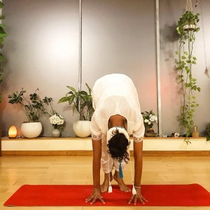 Charisma Whitefeather from Siesta Yoga in Los Angeles demonstrating the up position of the Kundalini Yoga Frog Pose