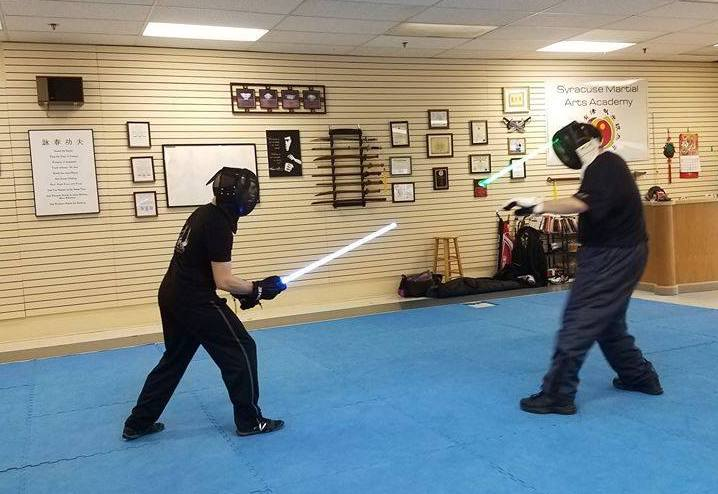 Benjamin Judkins (right) sparring with his Lightsaber Combat instructor, Anthony Iglesias at a TPLA school in New York State.