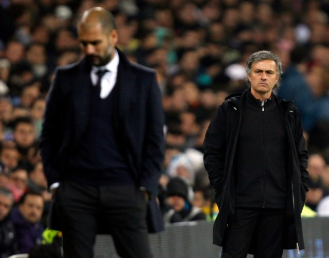 10 Dec 2011, Madrid, Spain --- Real Madrid's coach Jose Mourinho (R) looks at Barcelona coach Pep Guardiola after Xavi Hernandez goal during their Spanish first division soccer match, the Clasico, at the Santiago Bernabeu stadium in Madrid, December 10, 2011. REUTERS/Sergio Perez (SPAIN - Tags: SPORT SOCCER) --- Image by © SERGIO PEREZ/Reuters/Corbis