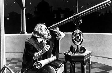 Galileo Galileo aan zijn telescoop