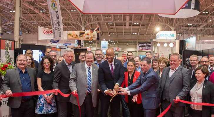 Organizers cut a ribbon to open Restaurants Canada Show