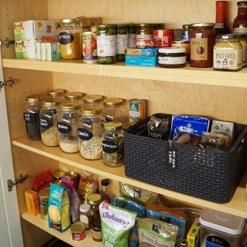 Organized Pantry with Container Store Products and Chalk Labels