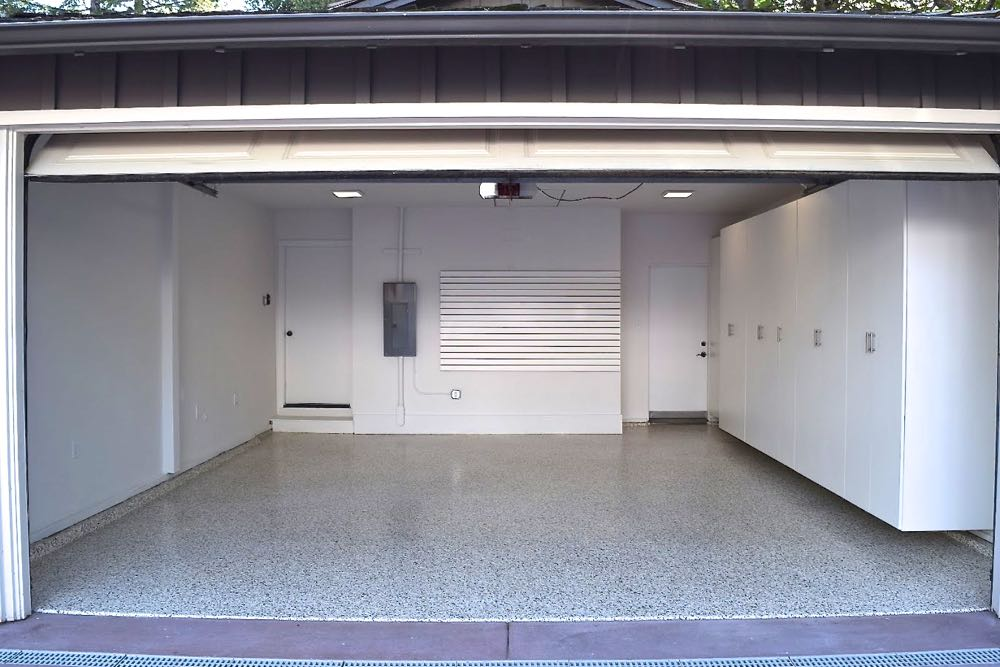 Organized Garage with Custom Cabinets, Slat Walls, and Epoxy Flooring