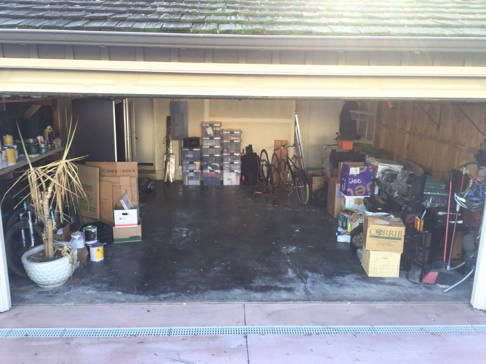 "Unorganized Garage ""Before"" working with Kuzak's Closet"