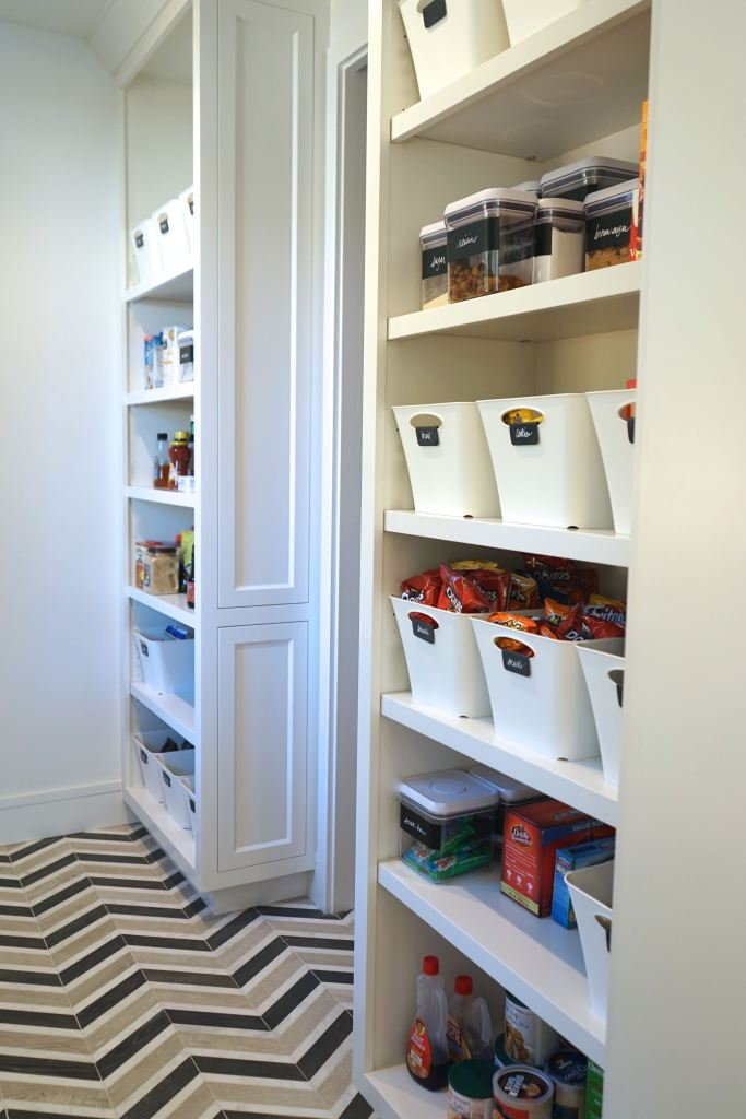 Over the top pantry and mudroom with designer tile, custom cabinets, and major organization