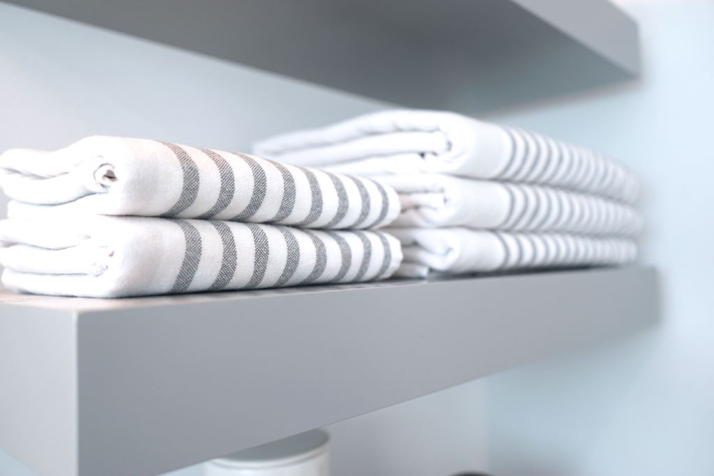 Floating shelves with decorative towels from Serena and Lily