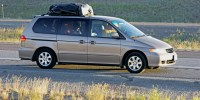 Mini van with people traveling on vacation