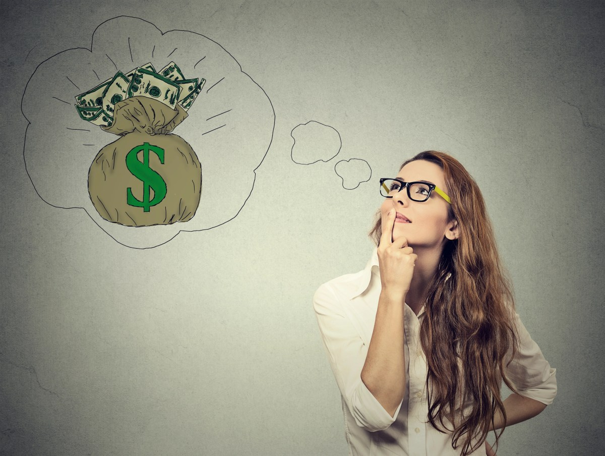 Woman dreaming of financial success