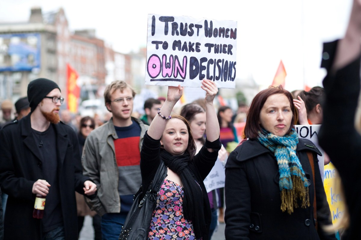Dublin, Ireland - September 29, 2012: Dublin March for Choice 2012, Young woman holds hand made poster in act of support other women about their decisions regarding abortion