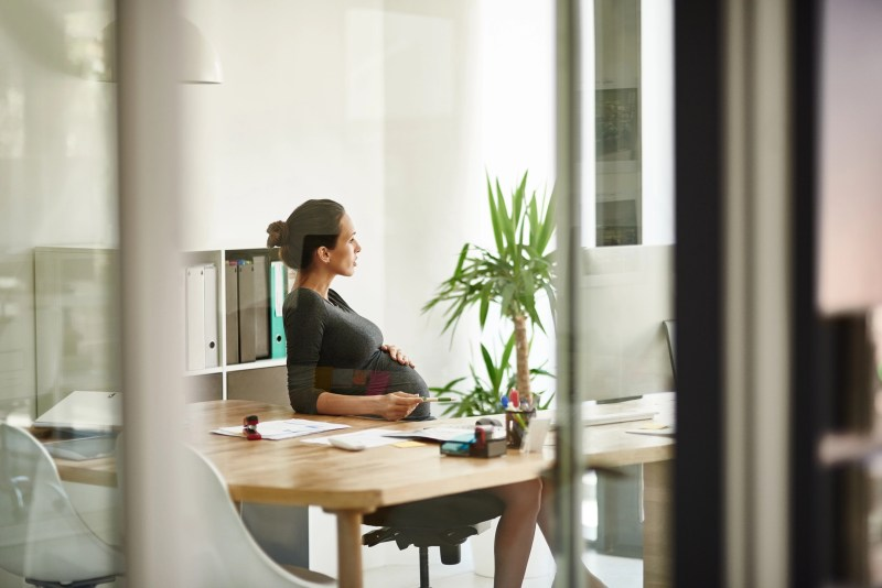 Shot of a pregnant businesswoman sitting in her office